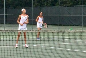 Madeline Earle and Pallavi Kawatra prepare to return a serve in their doubles match at Long Branch High School on Oct. 20. Photo by Nicole LoRusso