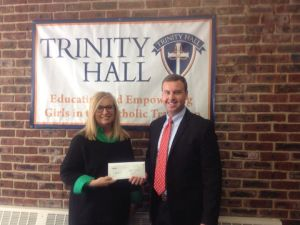 STEM teacher Kali Lambrou accepts the First Energy $500 STEM Classroom Grant  from Kieran Tintle