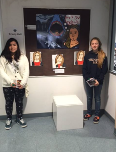 Pictured Two Students in front of art work done at Monmouth Teen Art Festival