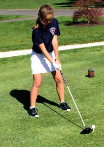 Freshman Jacqueline Munro lines up before a swing. Photo by Olivia DeNicola