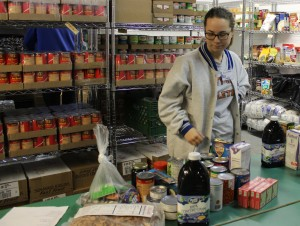 Freshmen Lindsey Bischoff organizes food to be donated. Photo by Melissa Whelan