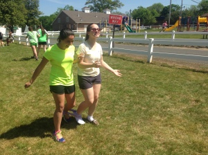 Alessandra S. and Lindsay B. compete in the three-legged race during Field Day on May 14. Photo by Alyssa Morreale.