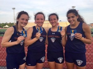 The 4x800 relay of Cate T., Caroline G., Isabelle P. and Gina R. show off their first-place medals at State Sectionals on May 22.