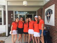 The golf team gathers before leaving school for a match. Photo by Ken Santos